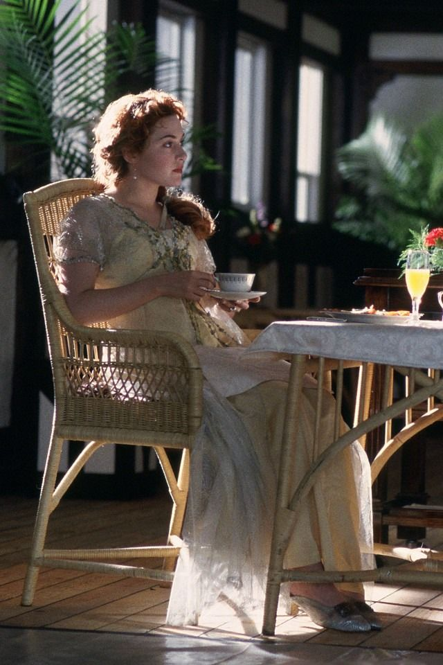 """Rose's morning/dressing gown in """"Titanic"""" : The gown is soft silk charmeuse with fine lace edging at the bodice. The robe is pure froth, ending in a small train; appliqué flowers frame the neckline and decorate the sleeves. Breakfast mules complete this ensemble."""