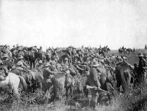 Members of the Seventh Contingent packing up camp in South Africa. The men and horses still look in reasonably good condition, in spite of the often harsh conditions they experienced Packing up camp during South African War | NZHistory, New Zealand history online