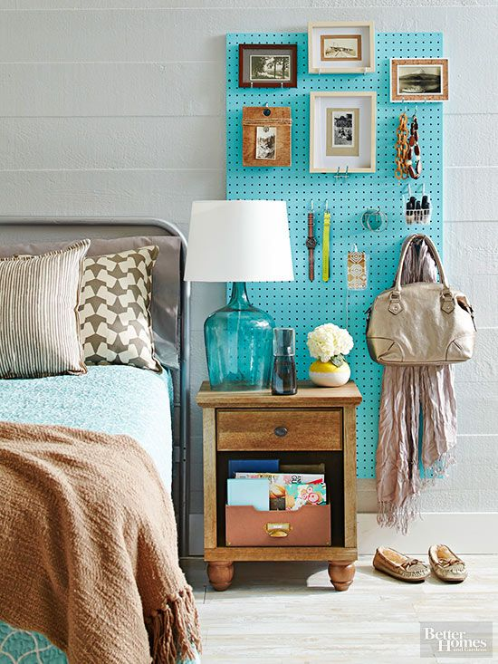 Pegboards aren't just for the garage anymore. Painted in a pretty hue, they're perfect for bedroom storage. To hang, use 1x2s to create a frame behind the pegboard. Then insert hooks of various types to display bags, accessories, and baskets of beauty products and electronics.