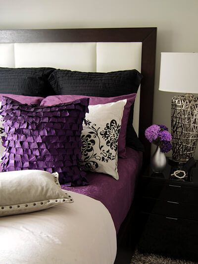 Neutral bedroom with purple accents