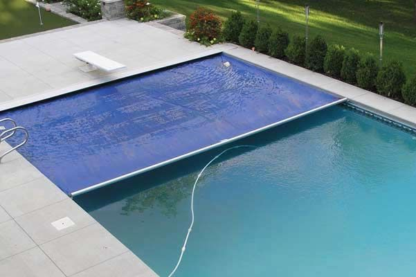 Automatic Retractable Safety Pool Covers Latham Pool Products - Latham Pools Pool safety covers, Swimming pool safety, Automatic pool cover