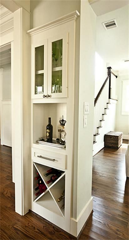 718 E 17th Houston, TX 77008: Photo A built-in wine cabinet flush with the wall enhances the utility of the home without sacrificing space.