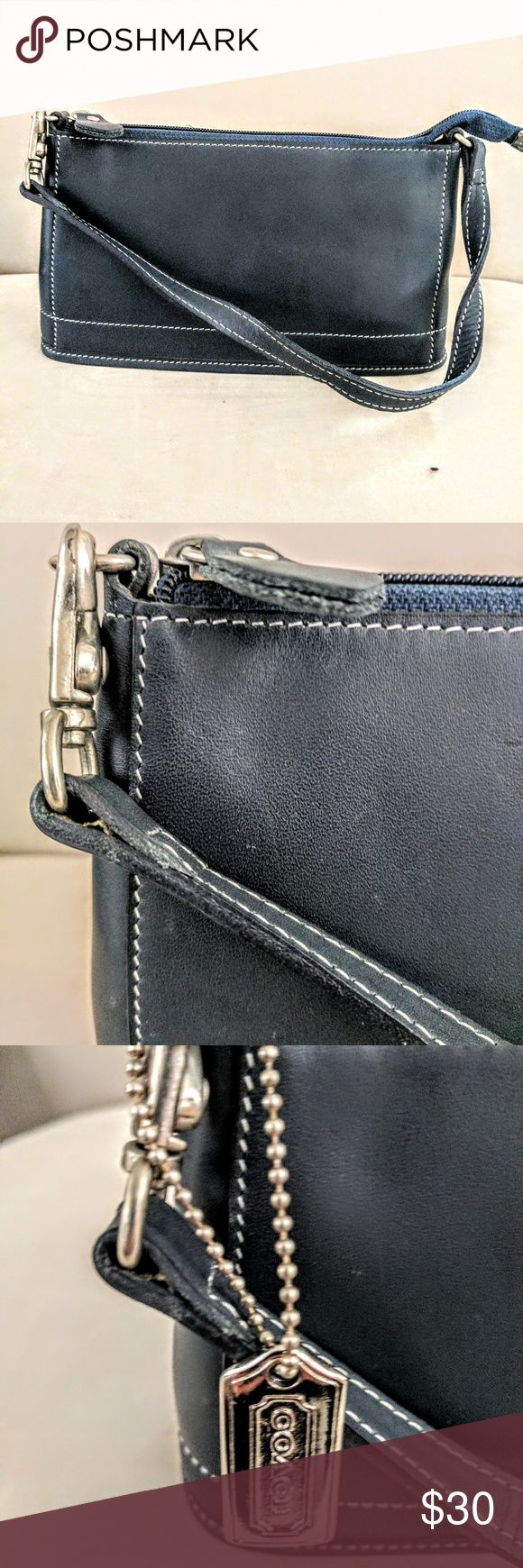 Vintage new Coach mini Navy leather mini pochette bag Coach Leatherware from the 90's. Got it as a gift and never took it out of the box. Great basic! Coach Bags Mini Bags