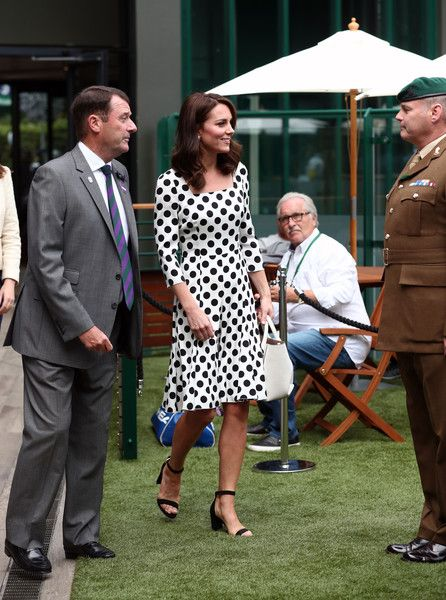 Kate Middleton Photos Photos - Catherine, Duchess of Cambridge, Patron of the All England Lawn Tennis and Croquet Club (AELTC) with AELTC Chairman Philip Brook (L) as she meets servicemen and women on day one of the Wimbledon Championships at The All England Lawn Tennis and Croquet Club, in Wimbledon on July 3, 2017 in London, England. - The Duchess of Cambridge Visits the All England Lawn Tennis and Croquet Club