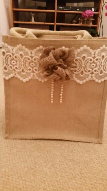 Take a plain hessian bag and pimp it with lace, pearls and a jute rose. Much admired in my shopping trolley.