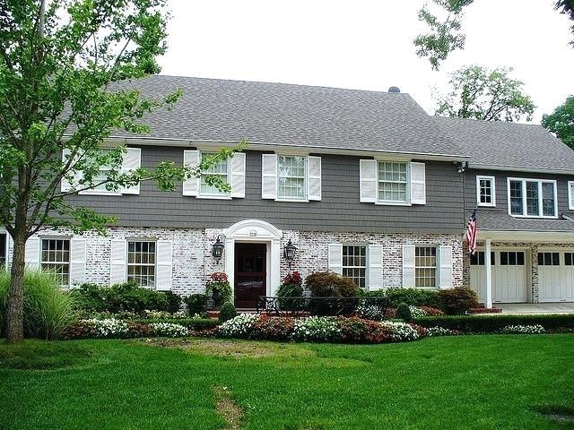 Brick And Siding Exterior Half Brick Half Siding House I Love The Color Exterior Paint Ideas Brick Brick Exterior House Exterior Brick Colonial House Exteriors