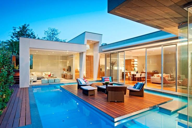 The pool at this house in Melbourne, designed by Canny Design, has an island for outdoor relaxing.