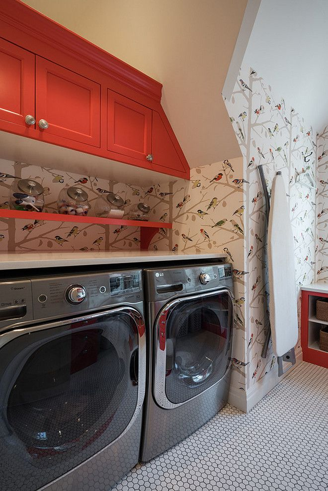 Red cabinet paint color. Laundry room with red cabinets. Laundry room with red cabinets and Schumacher paper A-Twitter wallpaper.…