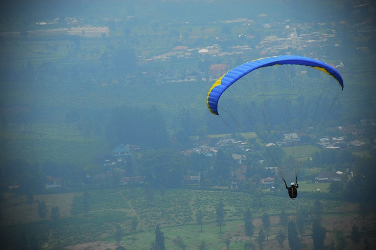 Is it a bird? A plane? No, and it's not superman either, but paragliding through the hill of Puncak, Bogor will surely make one feels like the flying Superhero.