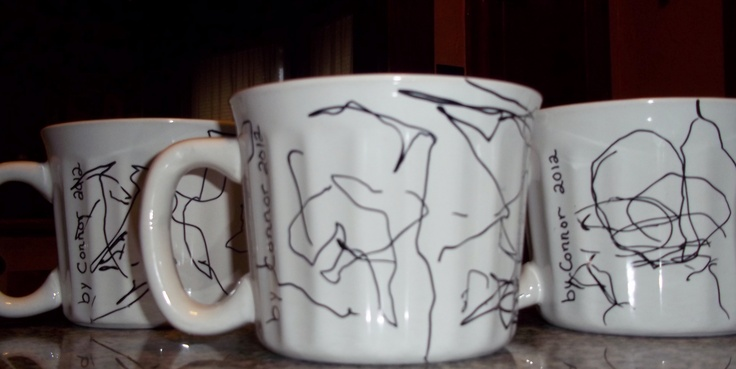 We actually made these!  White mugs from the Dollar Tree.  Wipe clean with alcohol.  My grandson drew pictures with a black Sharpie marker (black works best!).  Bake in a 350 oven for 30-min. Let cool and fill with candy to give as gifts or fill with coffee just to enjoy :)