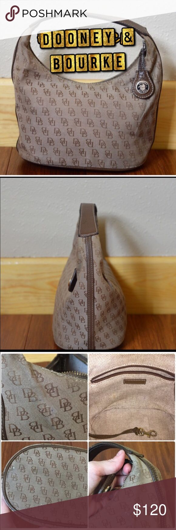 Signature Bucket Bag Vintage Defects: two ink pen dots on side, see pic. Small brown mark inside bag, see pic. Some wear near seams of handles and bottom of bag. Some of the brown dye in the leather has worn off on the handle Condition: Great  🚫smoke 🏡 with 🐈🐩.🚫Stain treatment due to skin allergy. Dooney & Bourke Bags