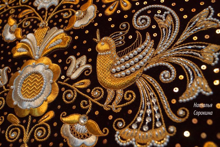 More details of the gold embroidery. Same photo without the Museum of glass.