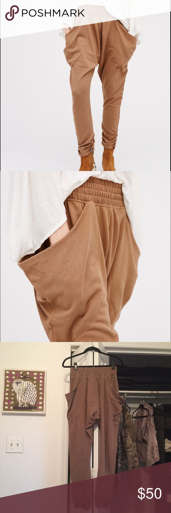 """FP harem pants """"So cool Harem Pant"""". Worn once briefly, perfect condition. *** Ultra comfy harem sweatpants featuring exaggerated hip pockets and elastic waistband for an effortless fit. Tapered leg with gathered hem detailing.  *95% Rayon *5% Spandex  Measurements for size: Small *Waist: 27.0 = 68.58 *Hips: 49.0 = 124.46 *Rise: 12.75 = 32.38 *Inseam: 26.5 = 67.31 Free People Pants Track Pants & Joggers"""