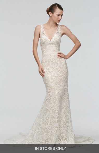 Watters Georgia Back Cutout Lace Trumpet Wedding Gown Exquisitely embroidered lace lends glamorous, vintage-inspired elegance.