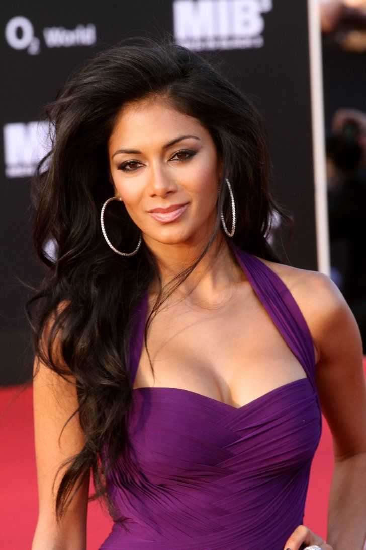 Pin for Later: Nicole Scherzinger Never Has a Bad Hair Day  Hitting Berlin for another Men in Black 3 premiere, Nicole opted for a more laid-back beauty look, with sexy windswept waves and a bronze smoky eye.