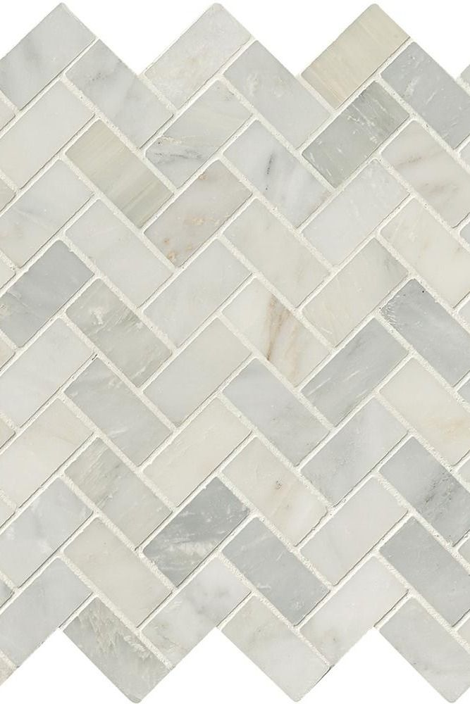 This mesh-mounted white marble mosaic tile in a herringbone pattern enhances any decor and is perfect for bathroom or kitchen renovations.