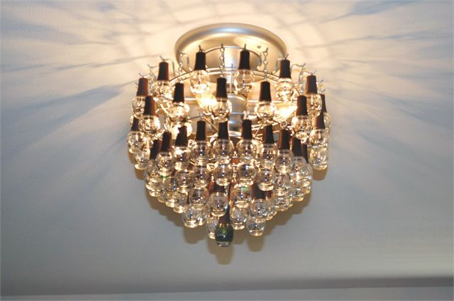 Amazing chandelier made out of SpaRitual nail polish bottles. Great re-use idea!!
