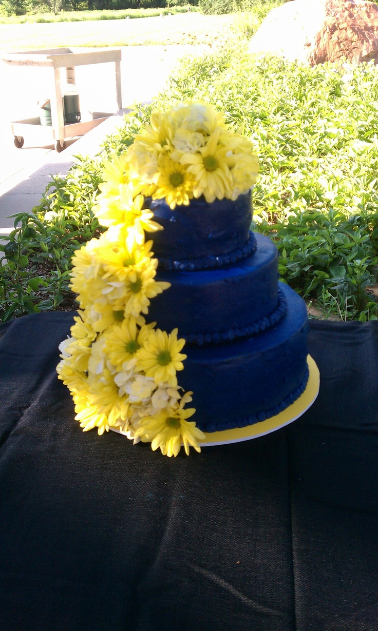 Blue Wedding Cake With Fresh Yellow Flowers