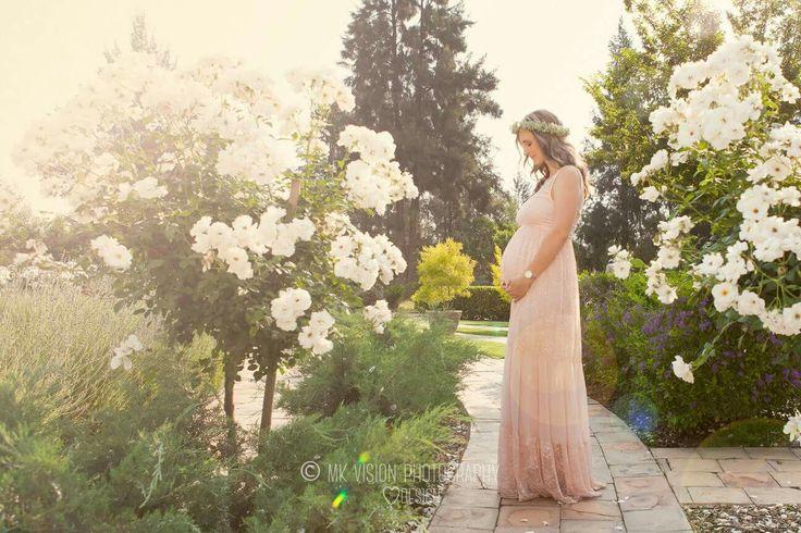 Pregnancy shoot among white roses