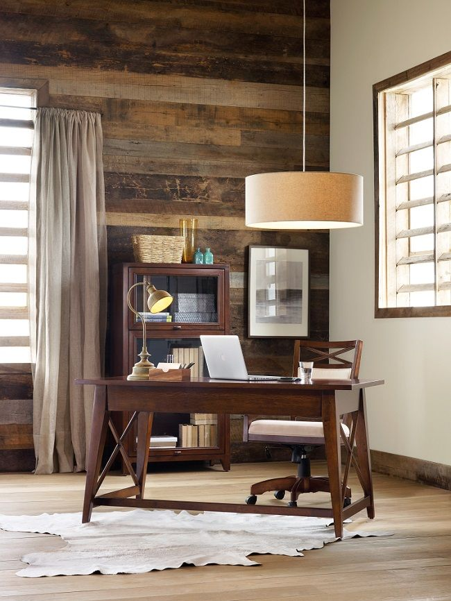Warm and rustic office with reclaimed wood wall. Love the