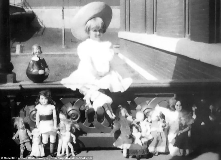 Collector: Huguette collected dolls throughout her life. She is pictured on  the porch of