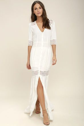 Save the best for last in the Amuse Society Last Call Ivory Lace Maxi Dress! Lightweight, gauzy fabric with eyelash lace and embroidered trim is formed to a short sleeve bodice. Full button placket travels from a V-neck down the maxi skirt with front slit.