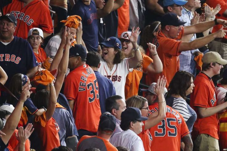 October 20, 2017: Fans at Game 6 of the ALCS, Houston Astros and New York Yankees. Fans cheer after Houston Astros catcher Brian McCann (16) hit a ground rule double to bring in a run during the fifth inning as the Houston Astros take on the New York Yankees in Game 6 of the ALCS at Minute Maid Park Friday, Oct. 20, 2017 in Houston. ( Michael Ciaglo / Houston Chronicle) Photo: Michael Ciaglo/Houston Chronicle