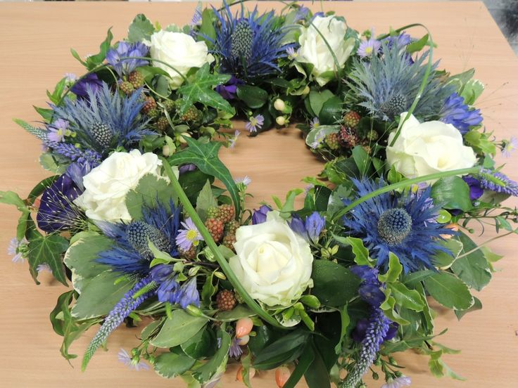 Scottish style design with beautiful blue alpine thistles, cream roses and berries