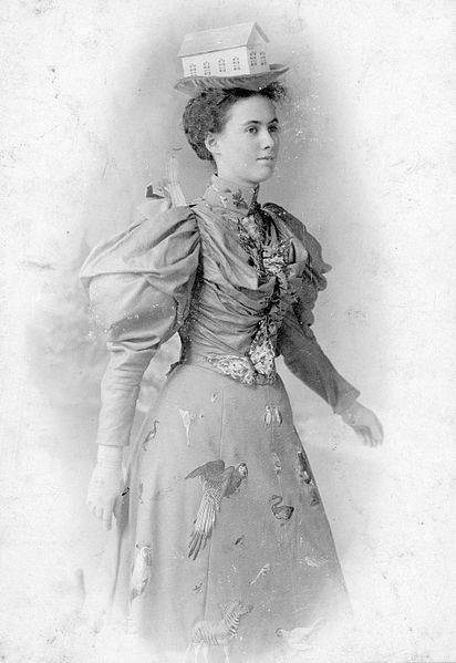 Frances Gwendolyn (née Francklyn) Castens] in her Noah's Ark costume, worn when skating, Halifax, Nova Scotia, Canada, 189-?. Frances was the daughter of George and Frances Francklyn and the g. grand-daughter of Sir Samuel Cunard. Her headpiece is complemented by a gown sporting appropriate fish, fowl and wildlife. Awesome.