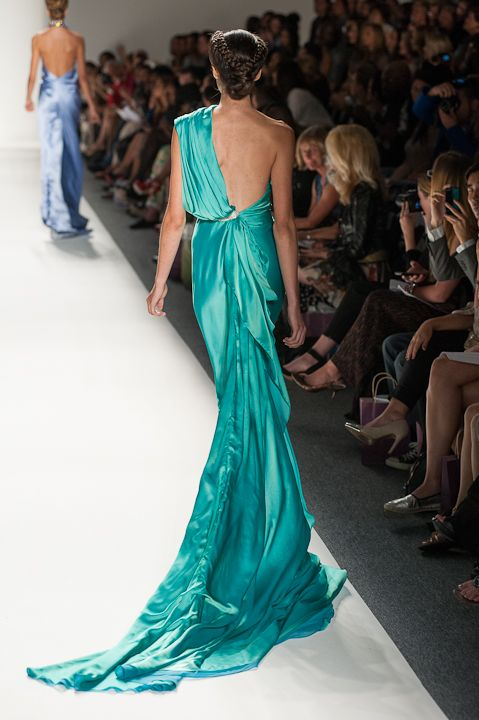 One shoulder turquoise evening gown with crystal belted waist