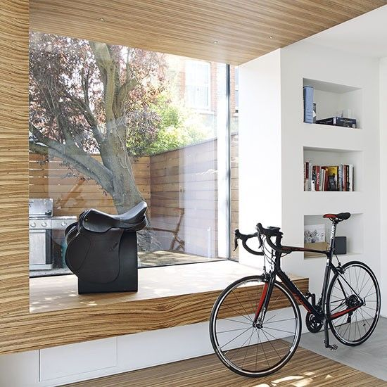 VC loves this seat The wood flowing from the ceiling down to the window  ledge creates a seamless, unified look