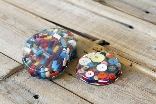 Put extra craft supplies to good use by fashioning these resin coasters.  Get the tutorial at Ashley Hackshaw.   - CountryLiving.com