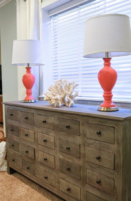 "Bureau/chest of drawers w/""coral"" decor piece and bright lamps. From 6th Street Design School: Family Basement Reveal"