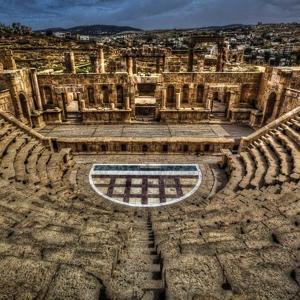 Jerash is considered the most well preserved Roman Ruins outside of Italy. It is also one of the busiest tourist sites in Jordan located only 45 minutes from Amman. Make sure to hire a guide to learn all about it. The market nearby is a great place to buy some local crafts too! http://theplanetd.com/jerash-amphitheatre-jordan-photography Discovered by The Planet D at Jarash, Jordan