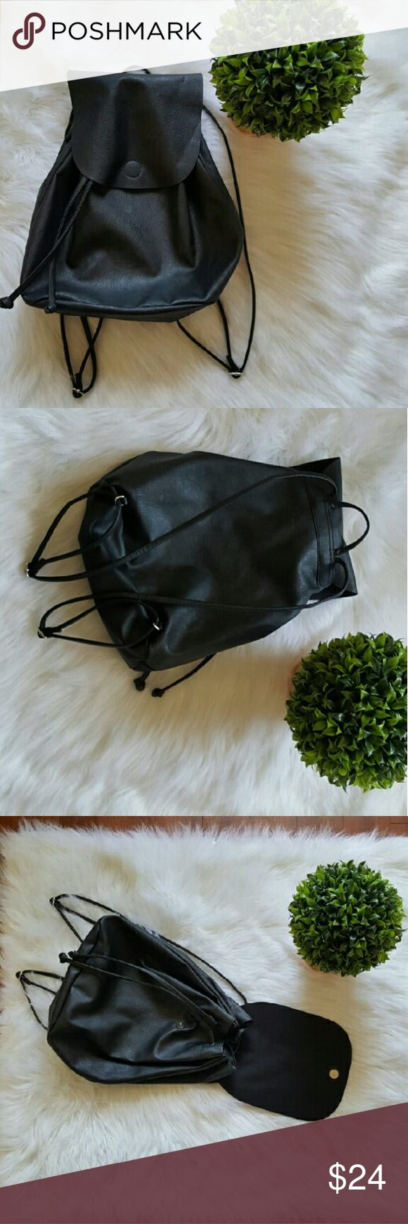 Black faux leather backpack Like new condition ? No flaws ? Adjustable straps ? perfect for festivals ? Bundle and save ? Beautiful inside and out ? Divided Bags Backpacks