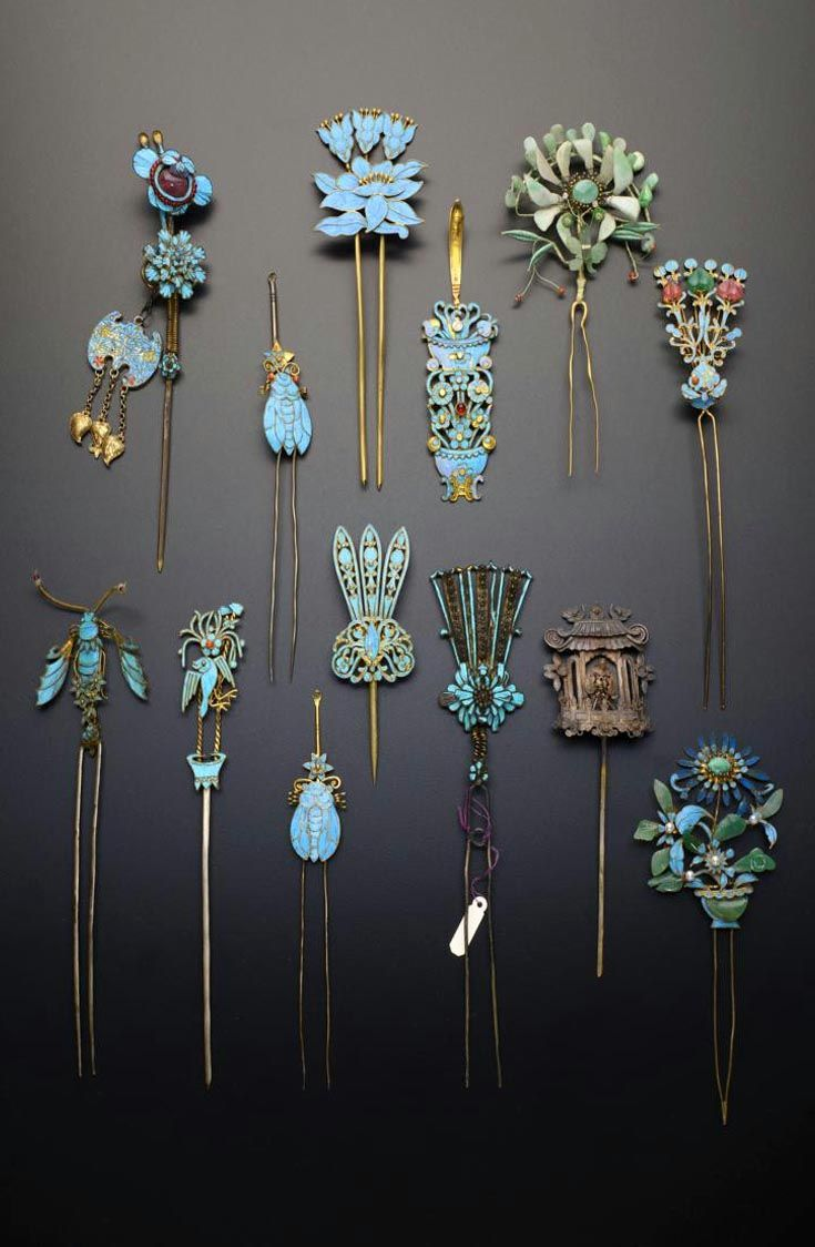 China | Collection of gilt metal and Kingfisher feather hair ornaments; formed as single and double pronged hairpins, four earpick-hairpins, one formed as a pagoda containing a seated figure, the others with foliate designs, insects and birds | Qing Dynasty
