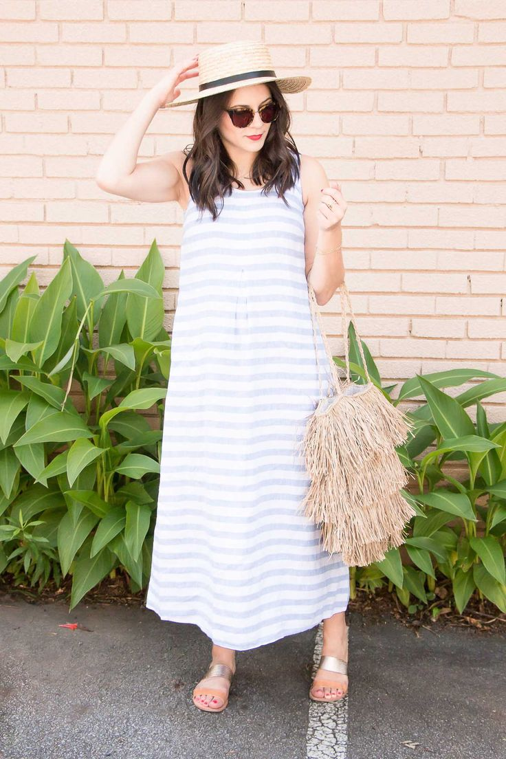 What To Wear On A Beach Vacation. Blue and white striped midi dress+silver and camel slides+beige fringend shoulder bag+hat+sunglasses. Summer Casual Outfit 2017