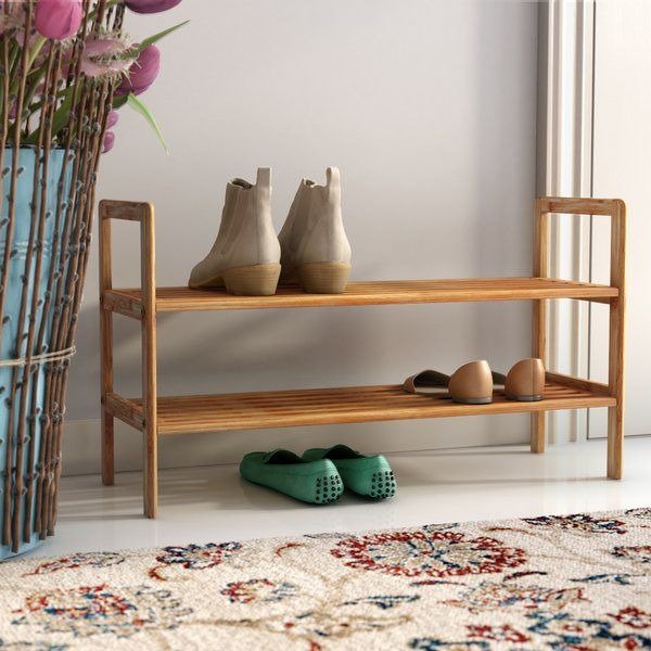 Use the Rebrilliant 2 Tier 8 Pair Shoe Rack for your home requirement or commercial arrangement; it is bound to prove its versatility, usefulness and traditional look. This 2 Tier 8 Pair Shoe Rack allows convenient organization of your shoes in a way that they all are easily accessible and visible at a single go. Crafted out of natural wood, this storage shelf is strong and can effectively carry the weight of up to eight pairs of shoes. The shelf will last longer due to the use of wood in…