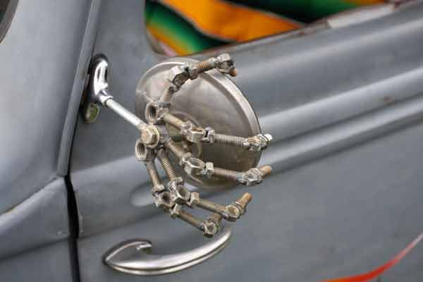 Very cool bolted skeletal hand holding the wing mirror.
