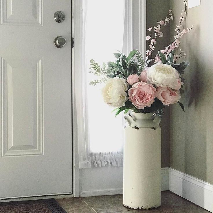 The farmhouse look has a soft side, too, as @rmhawk shows here.  Find our Metal Farmhouse Vase with Handles, and faux floral stems and sprays to fill it, via the Like2b.uy/Pier1 link in our profile.  #pier1love #farmhouse #florals