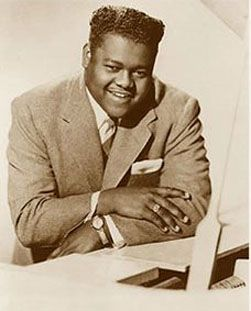 Fats Domino (American R & B rock and roll pianist singer song writer) has five gold million selling records before 1955 and had 35 top American 40 hits. He is known for his songs Ain't That A Shame, I'm Walking, Shake Rattle and Roll, The Girl Can't Help It, Blueberry Hill. . . . .