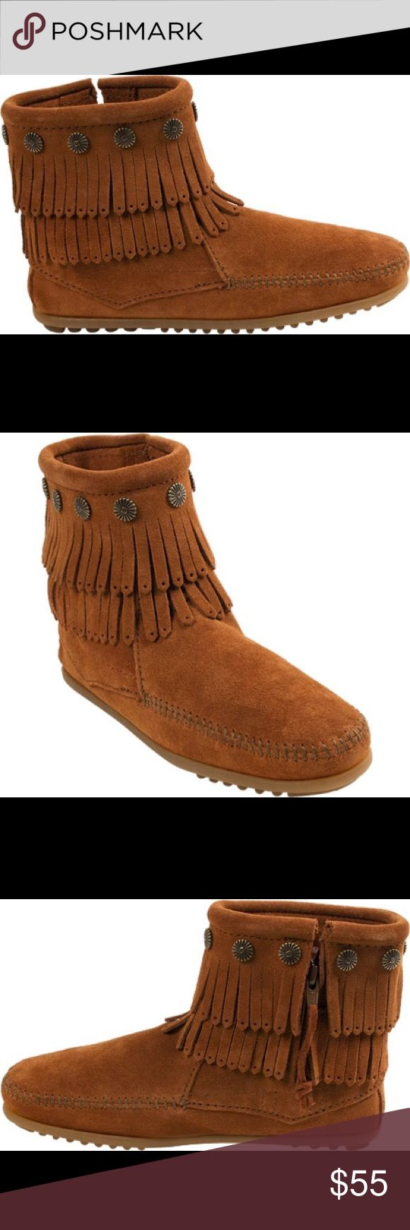 Minnetonka Double Fringe Classic Mocassin Boot What a classic. Never worn outdoors! These fringe side zip boots will keep your feet looking oh so fashionable this season. With metal conchos and a lightweight rubber sole these ankle boots look great with just a pair of jeans and a t shirt. Or pair with long or mini skirt to dress up a little.  Literally can be matched with almost any outfit. Fabulous gift!  #Mocassin boogie Minnetonka Shoes Winter & Rain Boots
