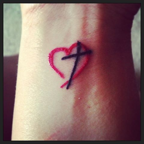 Heart and Cross tattoo.  1 day out and I adore it.