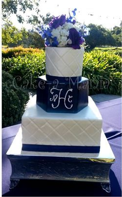 3 tier shimmer pillow pattern fondant wedding cake with navy blue hexagon middle tier and hand pipped monogram. www.cake-a-mania.com or FB/cakeamania