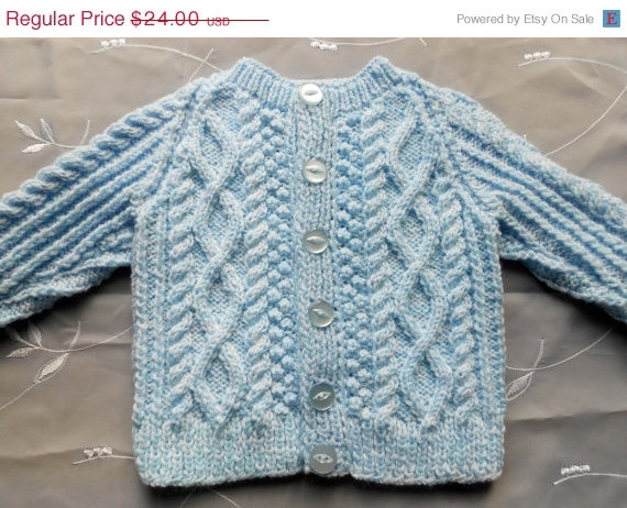 Baby boy sweater in light blue, hand knit. $19.20, via Etsy.