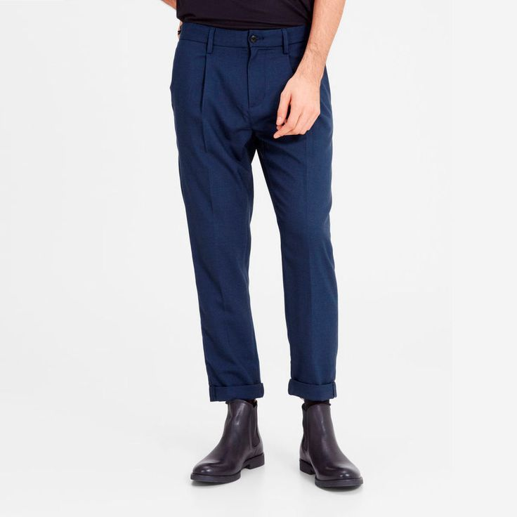 Comfortable and easy to style navy blue chino pants. Roll them up and pair them with high boots for a cool Scandinavian look | JACK & JONES