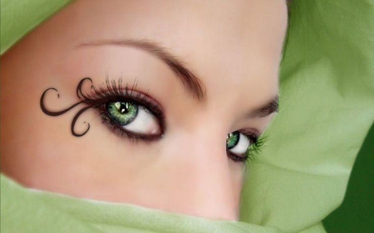 Woman Face With Beautiful Green Eyes
