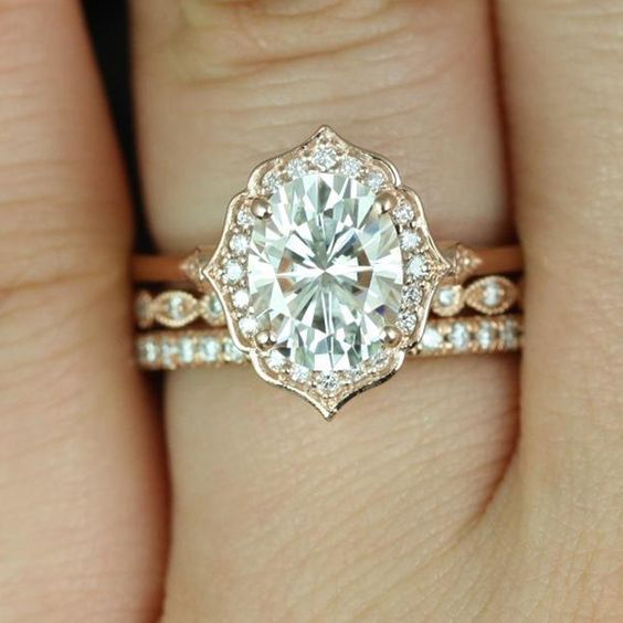 "The ""Mae"" halo engagement ring, from Rosados Box on Etsy, showcases moissanite and diamonds and is set in 14k rose gold. #weddingring"