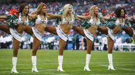 Miami Dolphins cheerleaders perform at a Miami Dolphins versus New York Jets football game at Wembley Stadium in London, England on April 10, 2015. A former cheerleader divorced her husband in support of President Donald Trump, according to a report on July 26, 2017.: Miami Dolphins cheerleader divorced her husband in support of President Donald Trump