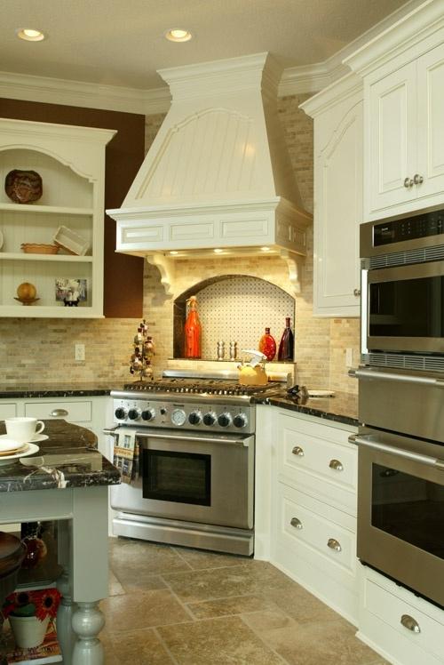 I like the stove in the corner. Love the hood.